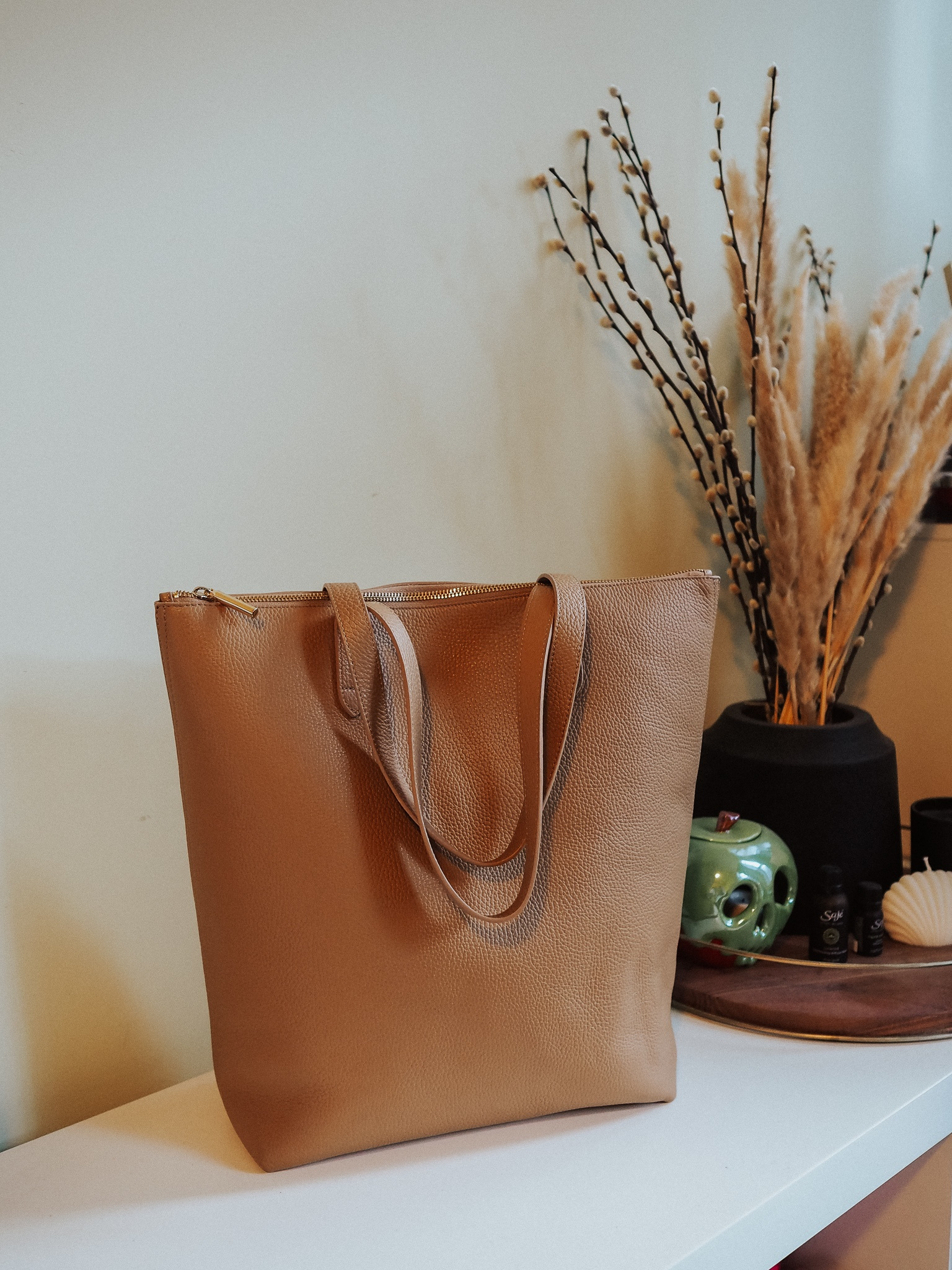 Trying to choose the best Cuyana leather tote? Look no further than the Tall Structured Zipper Tote in this blog post review.