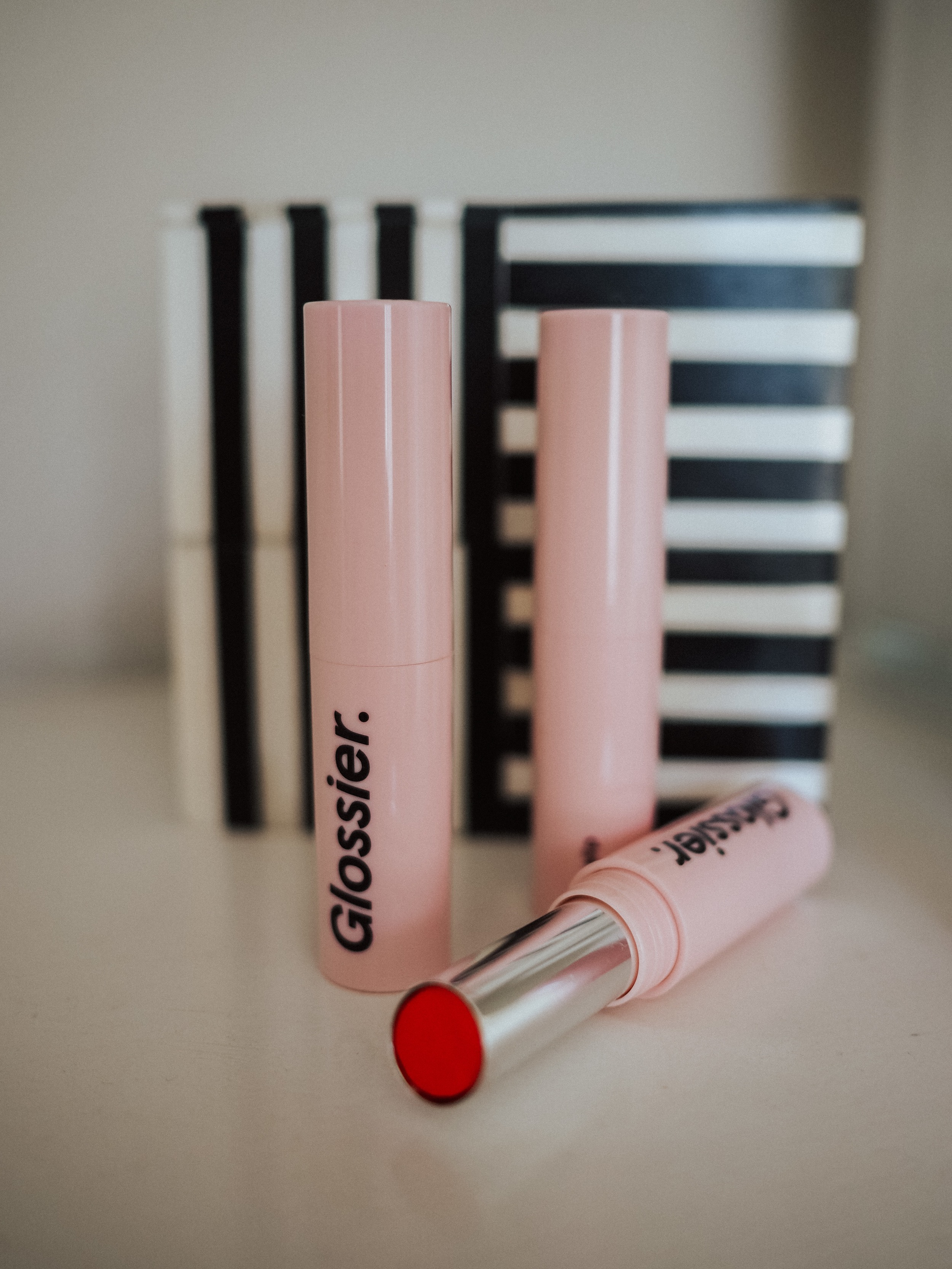 Kelsey from Blondes and Bagels reviews the NEW Glossier Ultralip! Find the pros, cons, and swatches of Ultralip in this review.