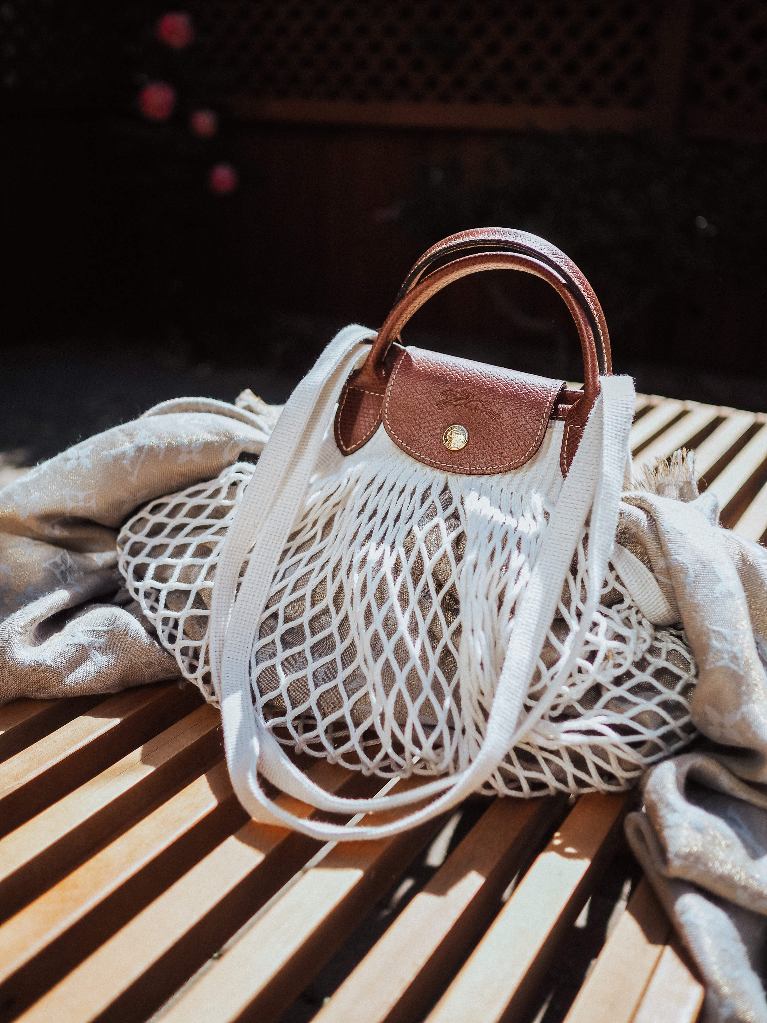 The classic nylon Longchamp Le Pliage is an undeniably popular style. The Filet version of the Le Pliage adds a new twist on an old favorite.